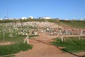 An expanding graveyard shows the impact of the HIV epidemic on a South African township