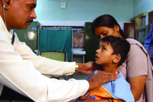 A doctor checks a child for symptoms of TB &#169 Gary Hampton